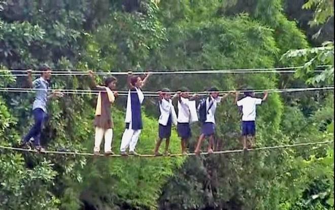 Kids crossing bridge in jungle.jpg