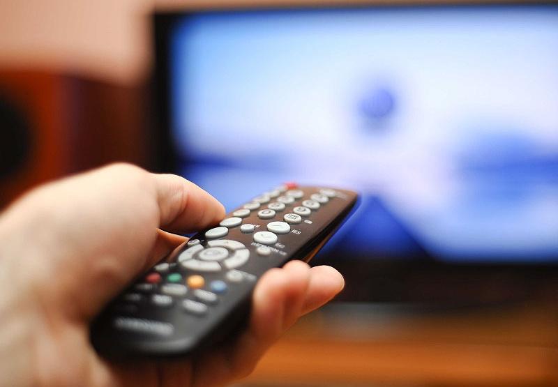 tv remote watching.jpg